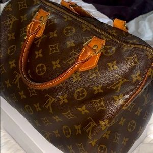 Authentic Louis Vuitton $575 or best offer.
